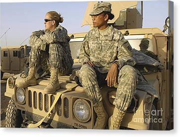 Two U.s. Army Soldiers Relax Prior Canvas Print by Stocktrek Images