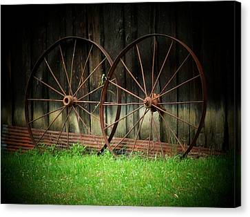 Two Wagon Wheels Canvas Print by Michael L Kimble