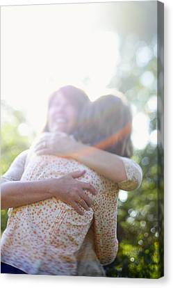 Two Women Hugging Each Other Canvas Print by Gillham Studios