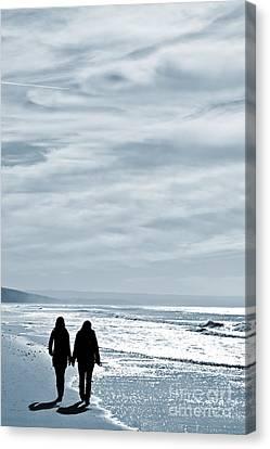 Two Women Walking At The Beach In The Winter Canvas Print by Jose Elias - Sofia Pereira