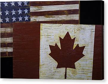 Two Wooden Flags American And Canadian Canvas Print