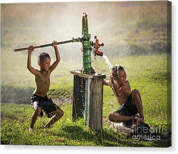 Canvas Print featuring the photograph Two Young Boy Rocking Groundwater Bathe In The Hot Days. by Tosporn Preede