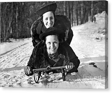Two Young Women On A Sled Canvas Print by American School