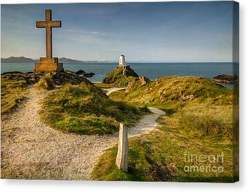 Twr Mawr Lighthouse Canvas Print by Adrian Evans