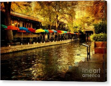 Umbrellas In The Riverwalk Canvas Print by Iris Greenwell