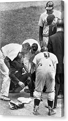 Umpire Down From Foul Tip Canvas Print by Underwood Archives