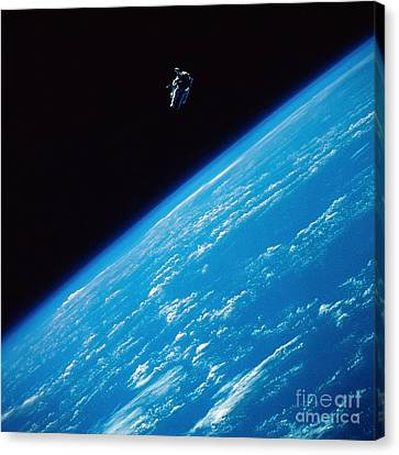 Unattached Space Walk Canvas Print by Stocktrek Images