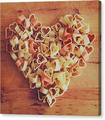 Uncooked Heart-shaped Pasta Canvas Print by Julia Davila-Lampe