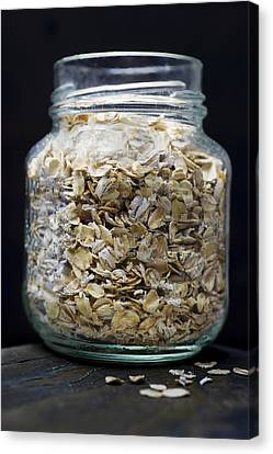Uncooked Oatmeal Flakes Canvas Print by Donald  Erickson
