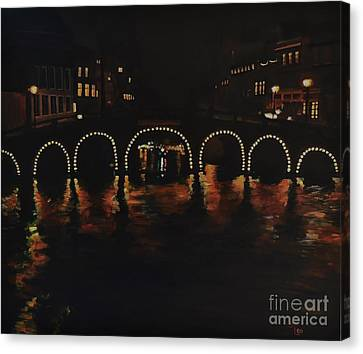 Under A Lighted Bridge In Amsterdam Canvas Print