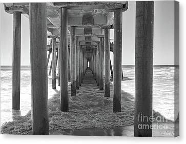 Canvas Print featuring the photograph Under Huntington Beach Pier by Ana V Ramirez