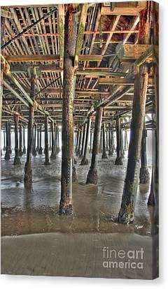 Canvas Print featuring the photograph Under The Boardwalk Pier Sunbeams  by David Zanzinger