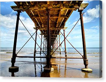 Under The Boardwalk Canvas Print by Sarah Couzens