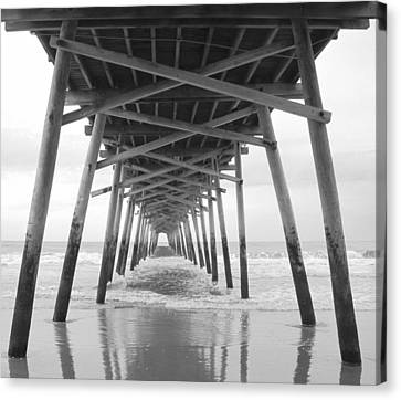 Under The Pier Canvas Print by Betty Buller Whitehead