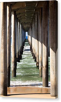 Under The Pier In Orange County California Canvas Print by Paul Velgos