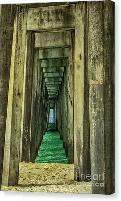 Under The Pier Canvas Print by Judy Hall-Folde
