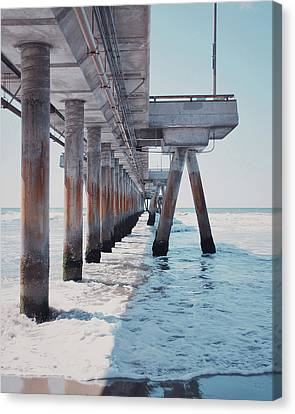 Under The Pier Canvas Print by Nastasia Cook