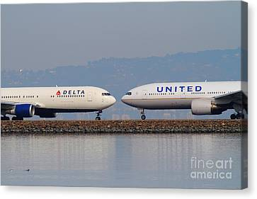 United Airlines And Delta Airlines Jet Airplane At San Francisco International Airport Sfo . 7d12091 Canvas Print by Wingsdomain Art and Photography