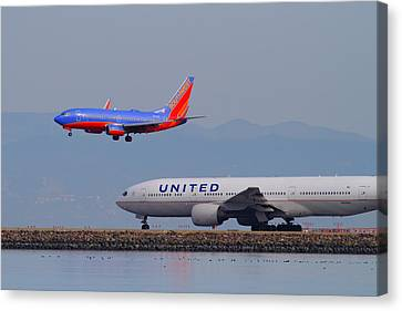 United Airlines And Southwest Airlines Jet Airplane At San Francisco International Airport Sfo.12087 Canvas Print by Wingsdomain Art and Photography