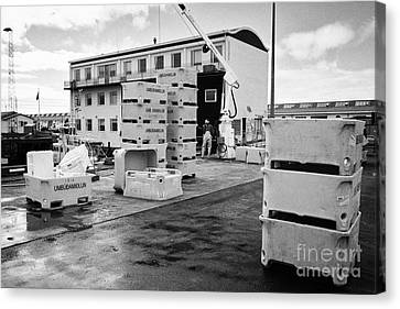 Unloading Fish Boxes From Fishing Boats In Reykjavik Harbour Iceland Canvas Print by Joe Fox