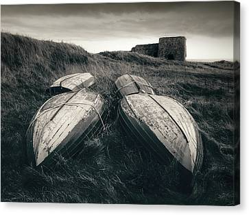 Upturned Boats Canvas Print by Dave Bowman