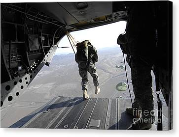 U.s. Airmen Jump From A Ch-47 Chinook Canvas Print by Stocktrek Images