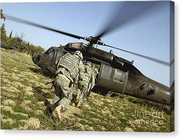 U.s. Army Soldiers Prepare To Board Canvas Print by Stocktrek Images