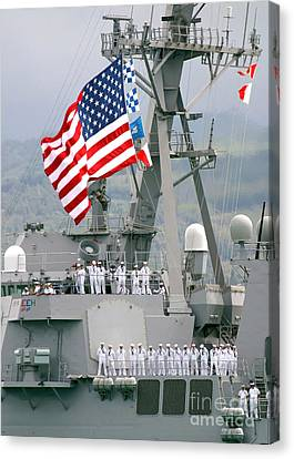 U.s. Navy Sailors Line The Rails Aboard Canvas Print by Stocktrek Images