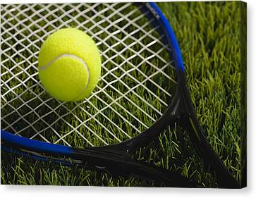 Usa, Illinois, Metamora, Tennis Racket And Ball On Grass Canvas Print by Vstock LLC