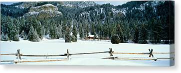 Usa, Montana, Fence, Cabin, Snow, Winter Canvas Print by Panoramic Images