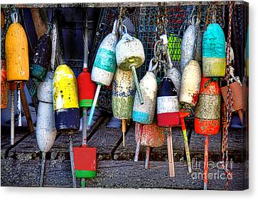 Used Lobster Trap Buoys Canvas Print by Olivier Le Queinec