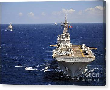 Uss Boxer Leads A Convoy Of Ships Canvas Print by Stocktrek Images