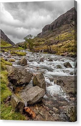 Valley Stream Canvas Print by Adrian Evans