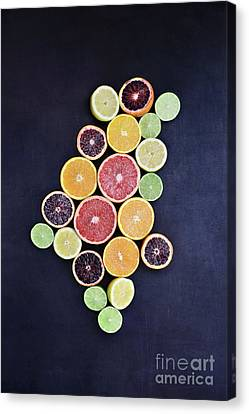 Canvas Print featuring the photograph Variety Of Citrus Fruits by Stephanie Frey