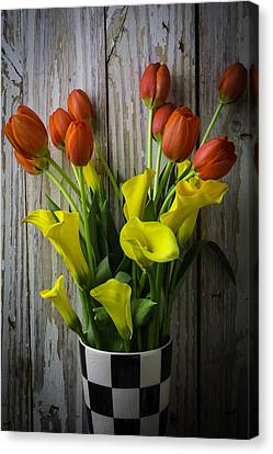 Vase With Tulips And Callas Canvas Print by Garry Gay