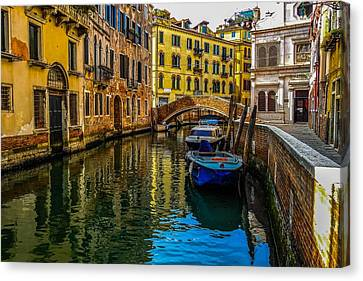 Venice Canal In Italy Canvas Print by Marilyn Burton