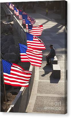 Veteran With United States Flags Canvas Print by John A Rodriguez