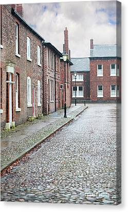 Victorian Terraced Street Of Working Class Red Brick Houses Canvas Print by Lee Avison