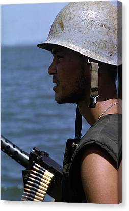 Vietnam War, A Navy Gunner Mans His 50 Canvas Print by Everett