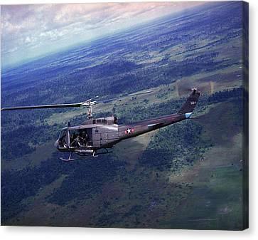 Vietnam War, Side View Of A Vietnamese Canvas Print by Everett