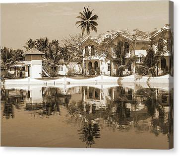 View Of The Cottages And Lagoon Water Canvas Print