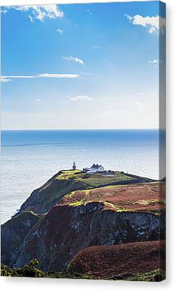 Canvas Print featuring the photograph View Of The Trails On Howth Cliffs With The Lighthouse In Irelan by Semmick Photo