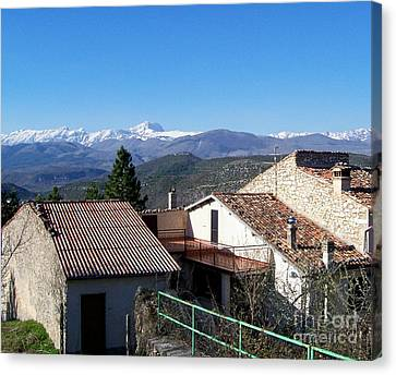 Village Rooftops Canvas Print by Judy Kirouac