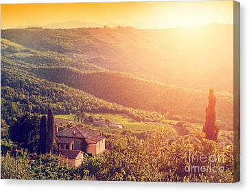 Vineyard And Farm House, Villa In Tuscany, Italy At Sunset Canvas Print by Michal Bednarek
