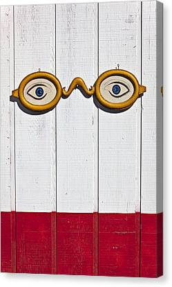 Vintage Eye Sign On Wooden Wall Canvas Print by Garry Gay