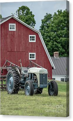 Vintage Ford Farm Tractor With Red Barn Canvas Print by Edward Fielding