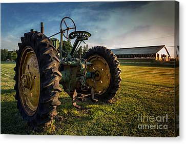 Vintage John Deere At Sunset Canvas Print by Edward Fielding