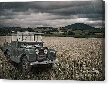 Vintage Land Rover In Field Canvas Print by Amanda Elwell