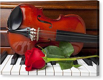 Violin With Rose On Piano Canvas Print by Garry Gay