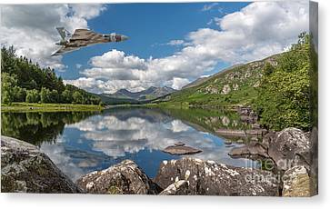 Vulcan Over Lake Canvas Print by Adrian Evans